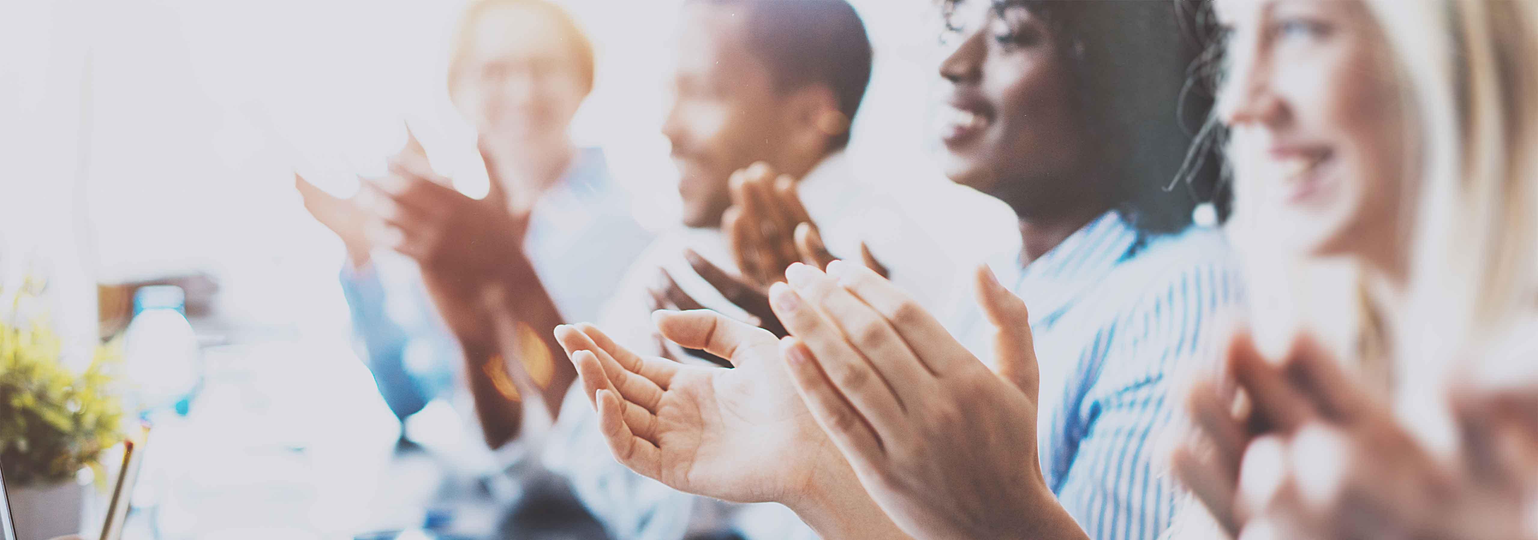 Business Coaching - Führungskräfte applaudieren
